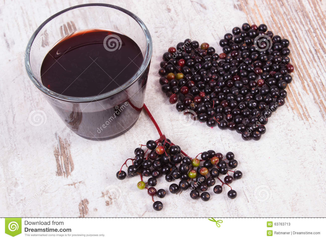Heart of elderberry and juice on old wooden background symbol of heart of elderberry and juice on old wooden background symbol of love biocorpaavc