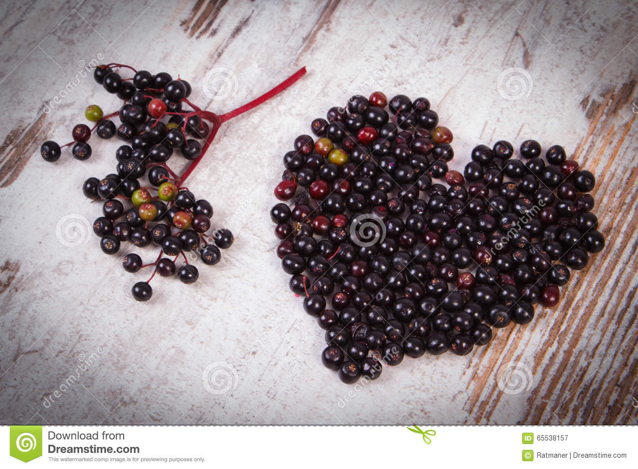 Heart Of Fresh Elderberry On Old Wooden Background Symbol Of Love