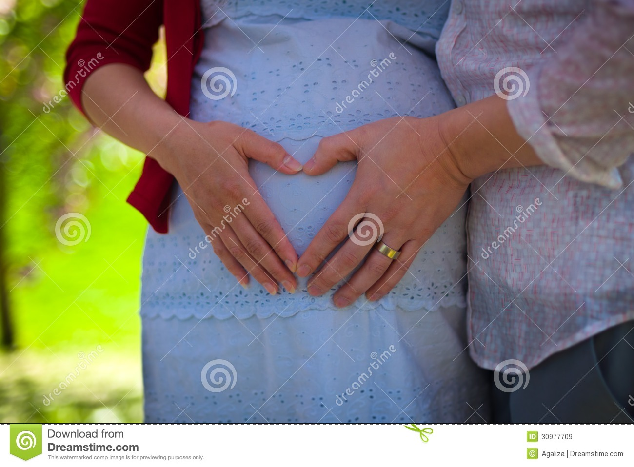 Heart Hands On Pregnant Wife's Belly Royalty Free Stock ...