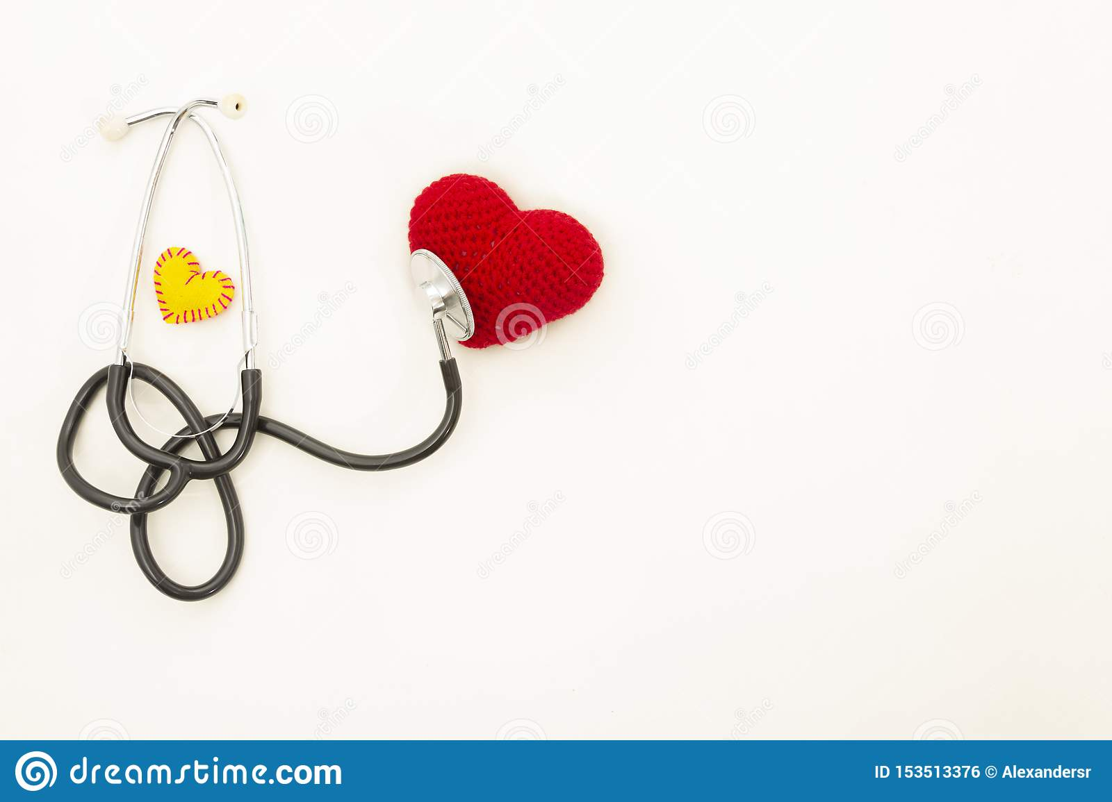 Heart health and prevention concept. Stethoscope and red heart of crochet on white isolated background with space for text