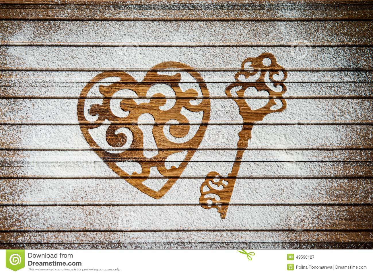 Heart And A Key Of The Flour As A Symbol Of Love On Wooden
