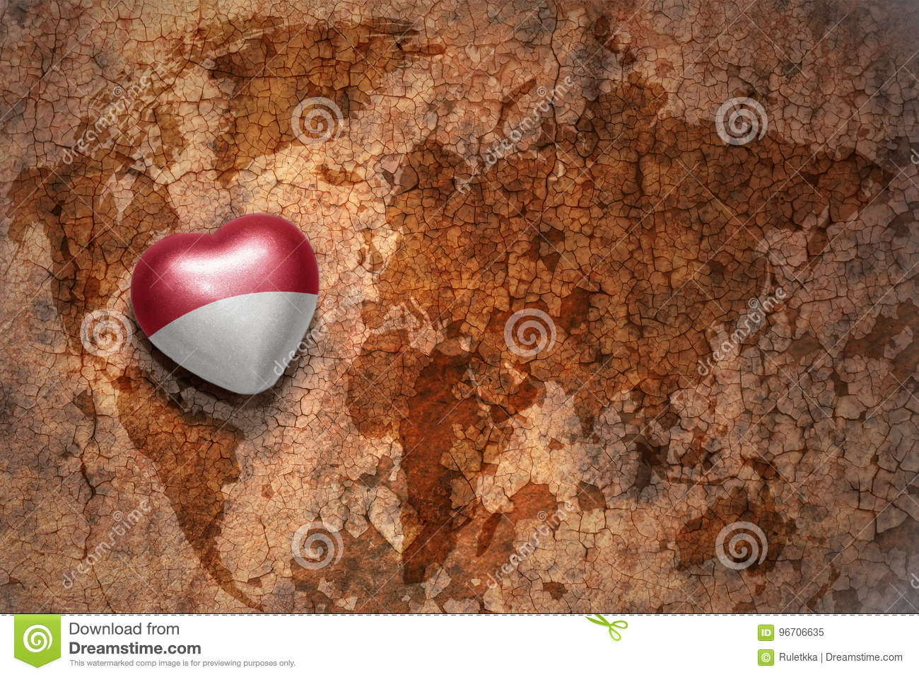 Heart with national flag of indonesia on a vintage world map crack paper background.