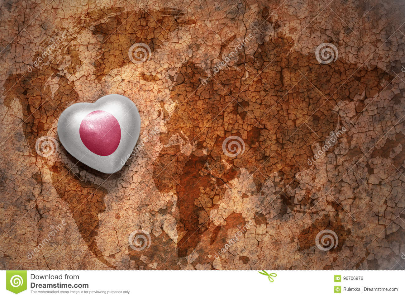 Heart with national flag of japan on a vintage world map crack paper background.