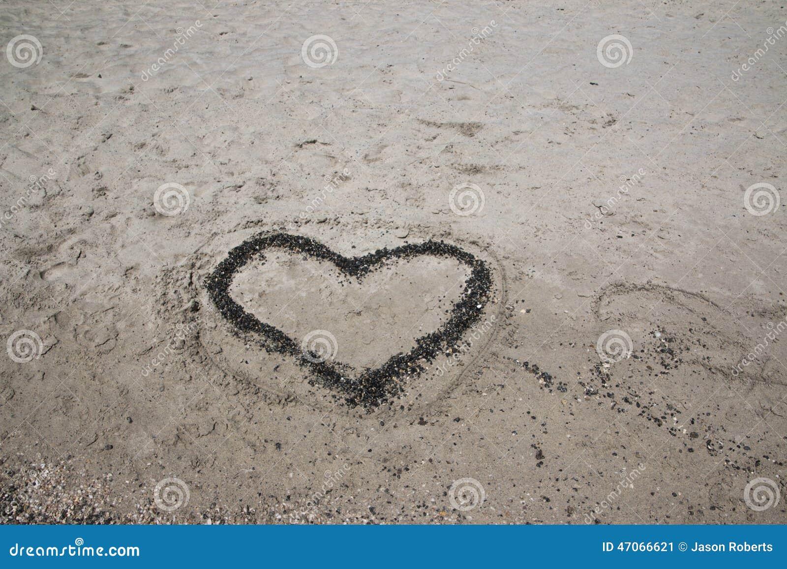 A Heart In The Sand On A Beach