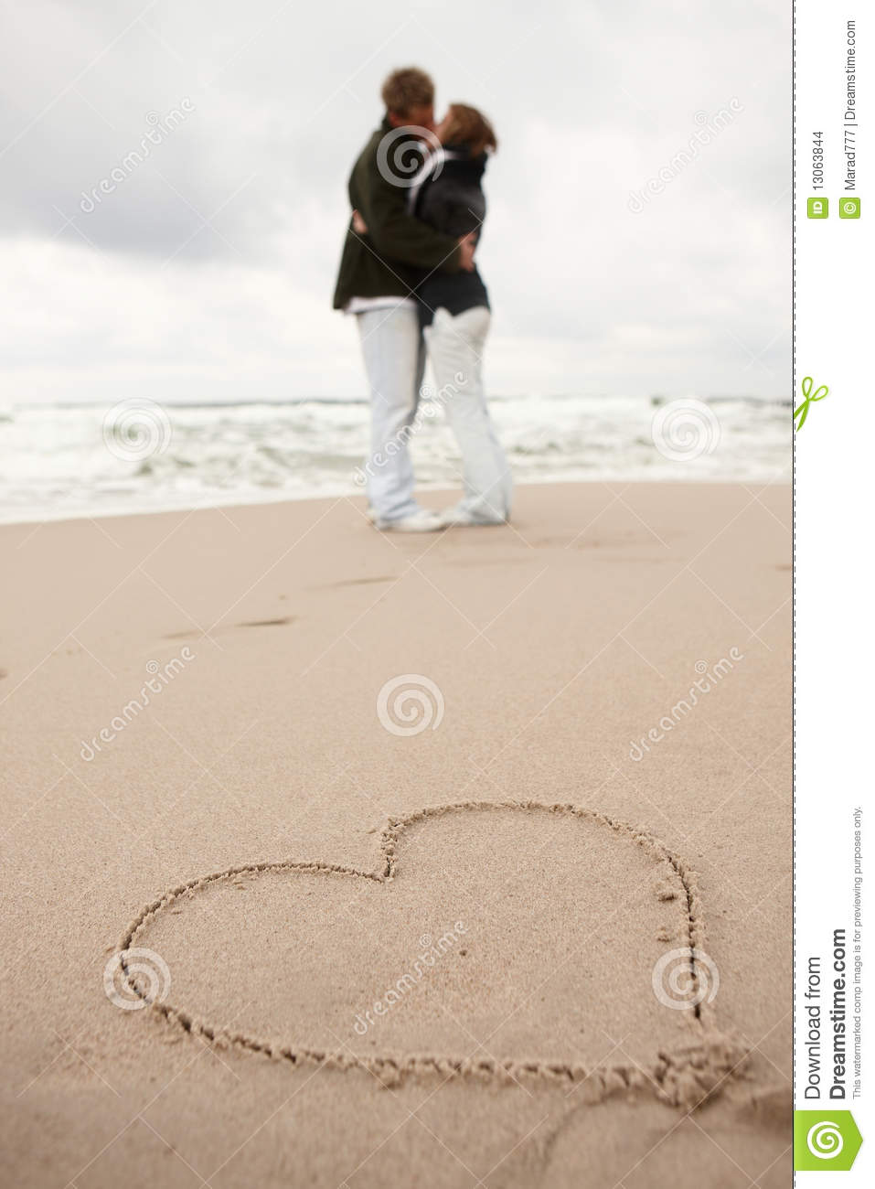 Heart on the sand two young lovers kissing stock images for 2 lovers pic