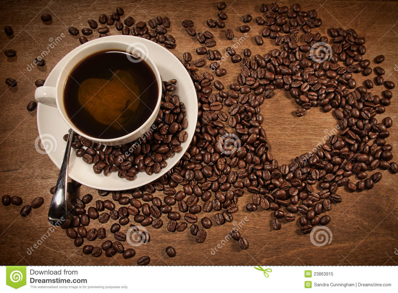 Heart shape from coffee beans on wood