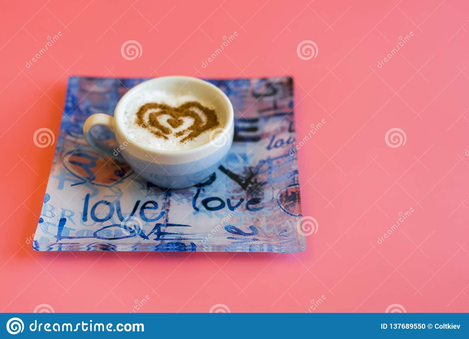 Heart Shape Coffee Cup Concept isolated on pink background. love cup , heart drawing on latte art coffee