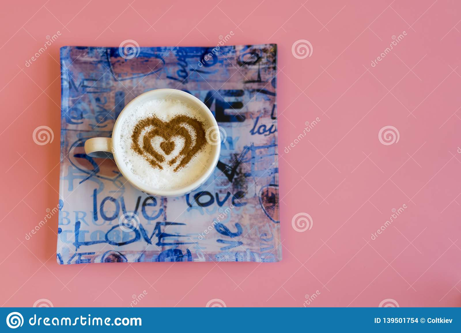 Heart Shape Coffee Cup Concept isolated on pink background. love cup , heart drawing on latte art coffee. copy space