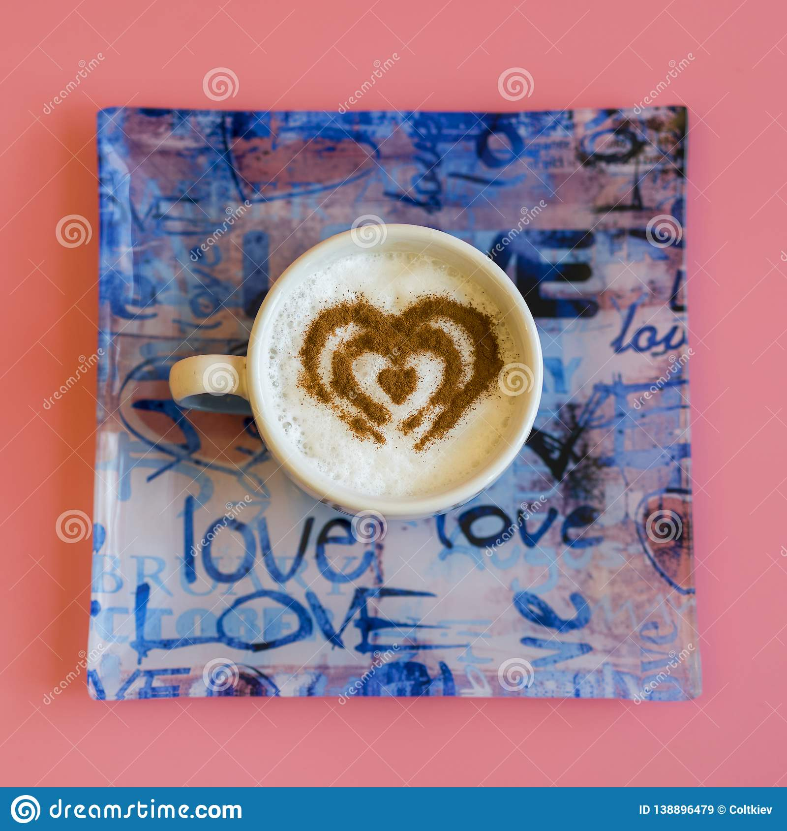 Heart Shape Coffee Cup Concept isolated on pink background. love cup , heart drawing on latte art coffee. square