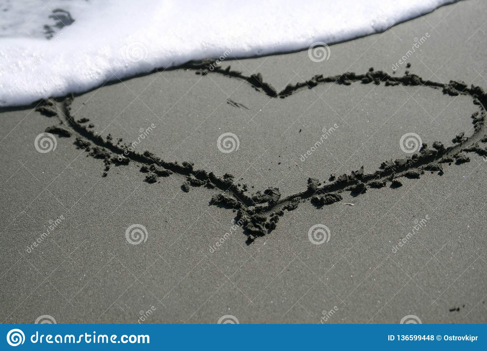 Heart shape drawing on the sand