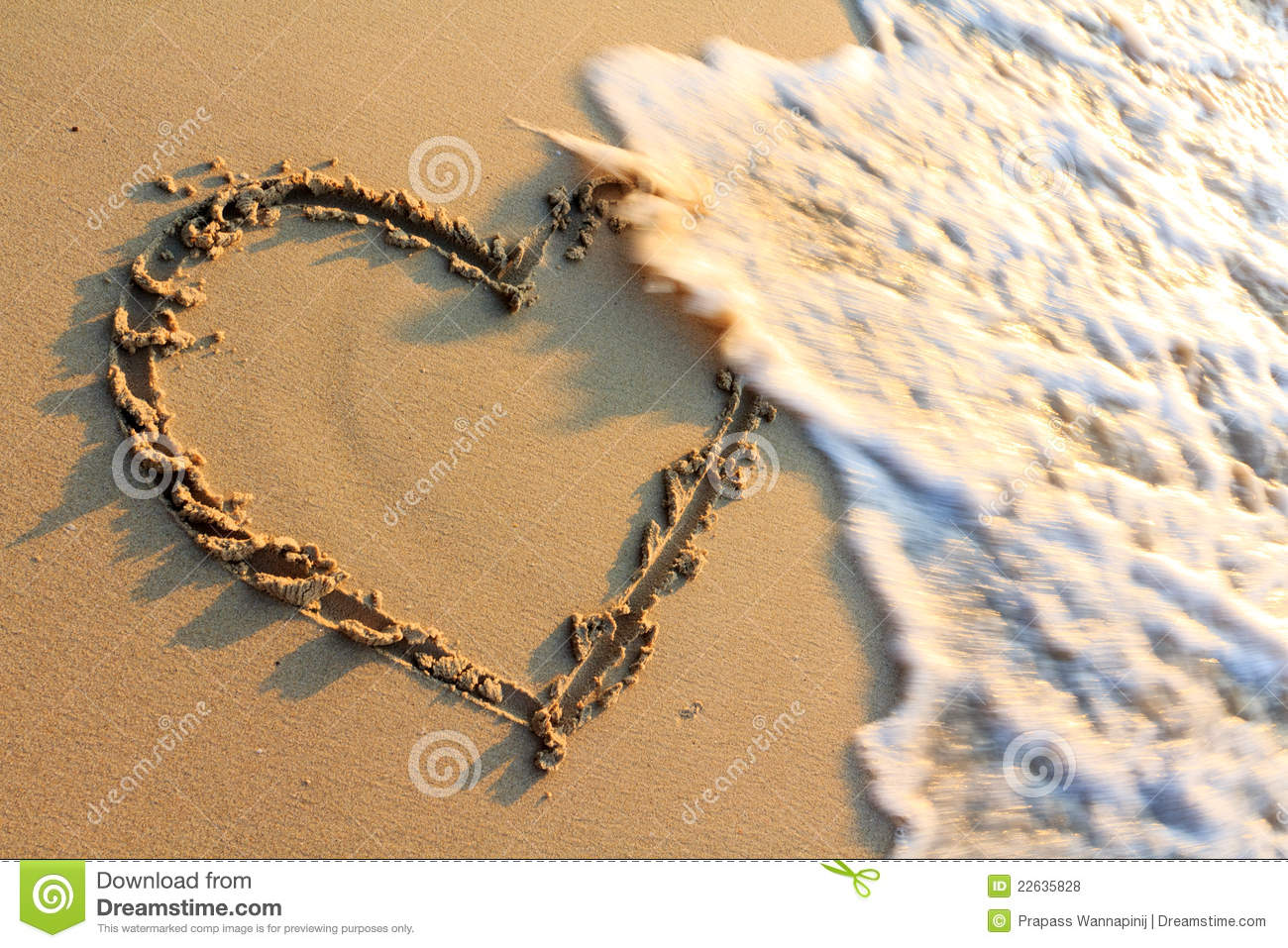 Heart shape hand drawing at a beach