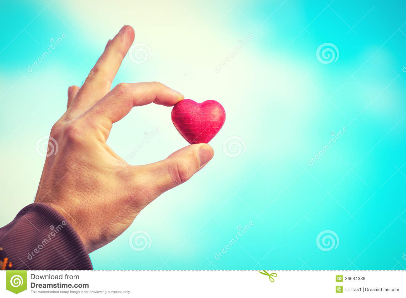 Heart shape love symbol in man hand valentines day holiday stock heart shape love symbol in man hand valentines day holiday buycottarizona Image collections