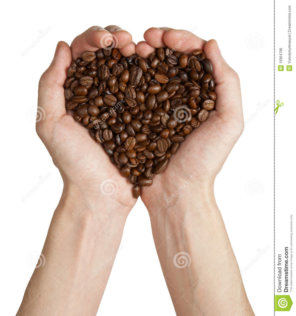 Heart shape made from coffee beans in hands
