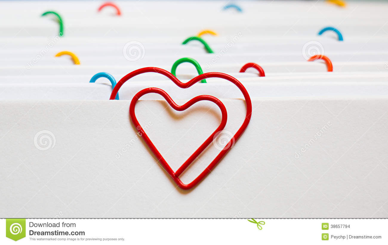 paper clip heart You will need two 1/2 balls of the mixed green clay for each paper clip you make flatten both balls with your finger lay the paper clip on the one of flattened balls.
