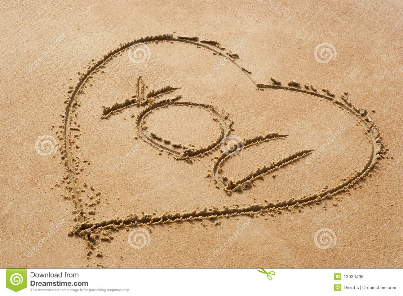 heart shape symbol with the word you on sandy beac stock photo
