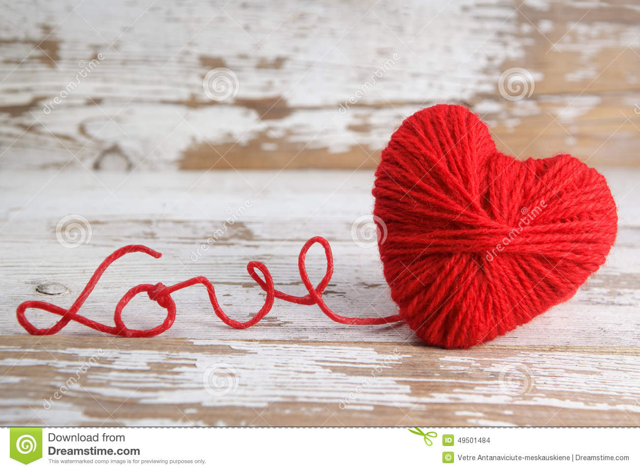 Heart Shaped Ball Of Yarn With Words Of Love Stock Photo