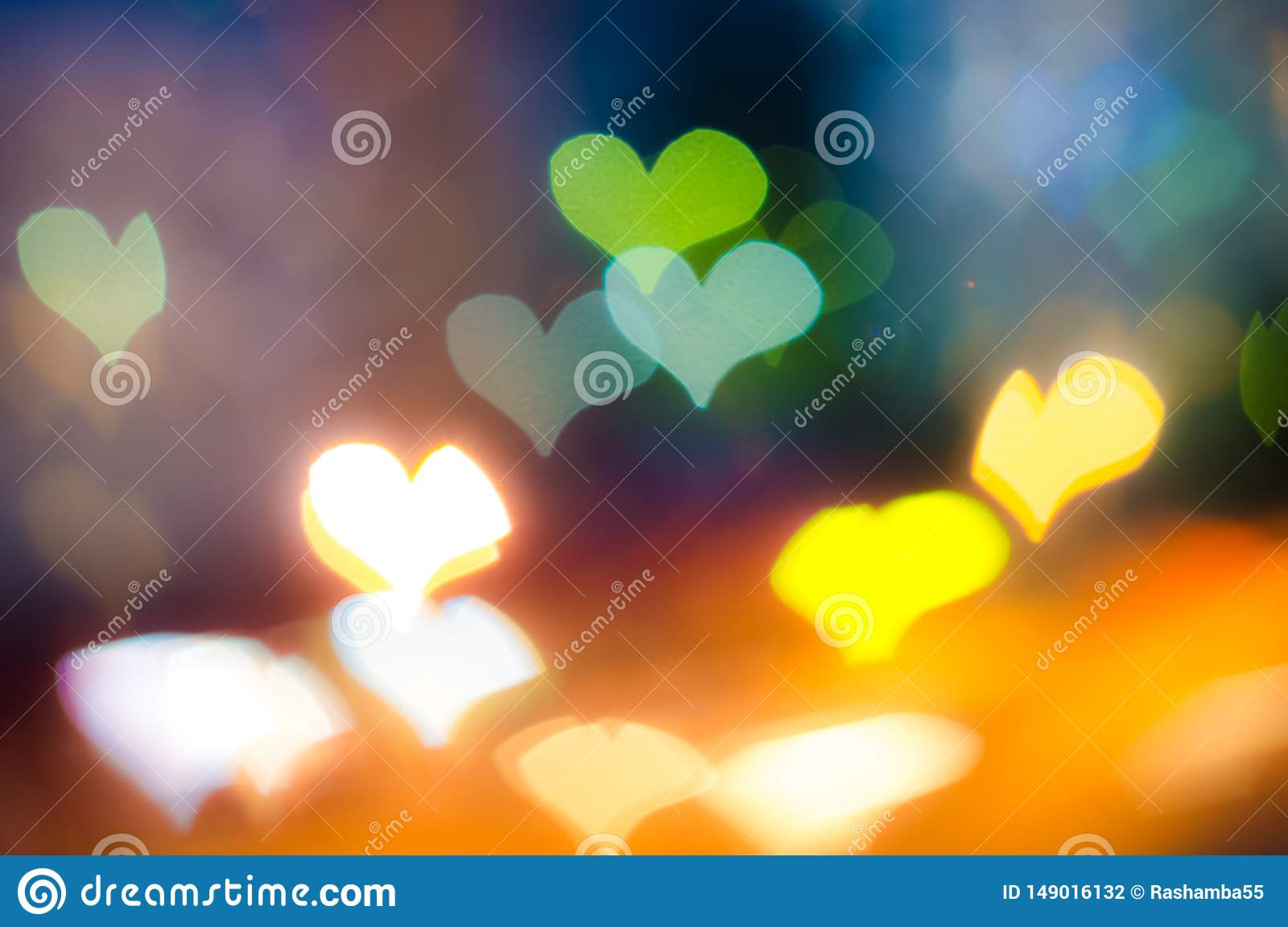Heart shaped Bokeh background on dark background