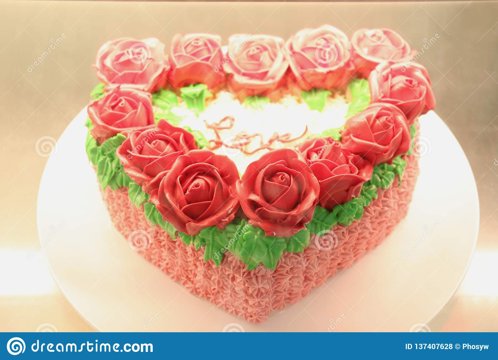 Heart Shaped Cake Decorated With Roses And Word Of Love On Top Stock