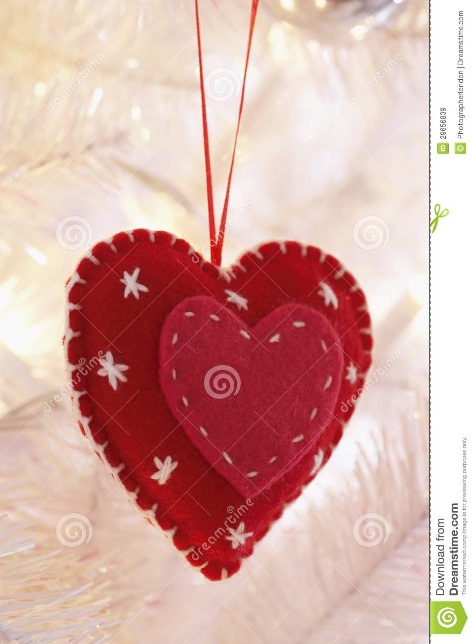 Heart shaped decoration hanging on christmas tree royalty for Heart shaped decorations home