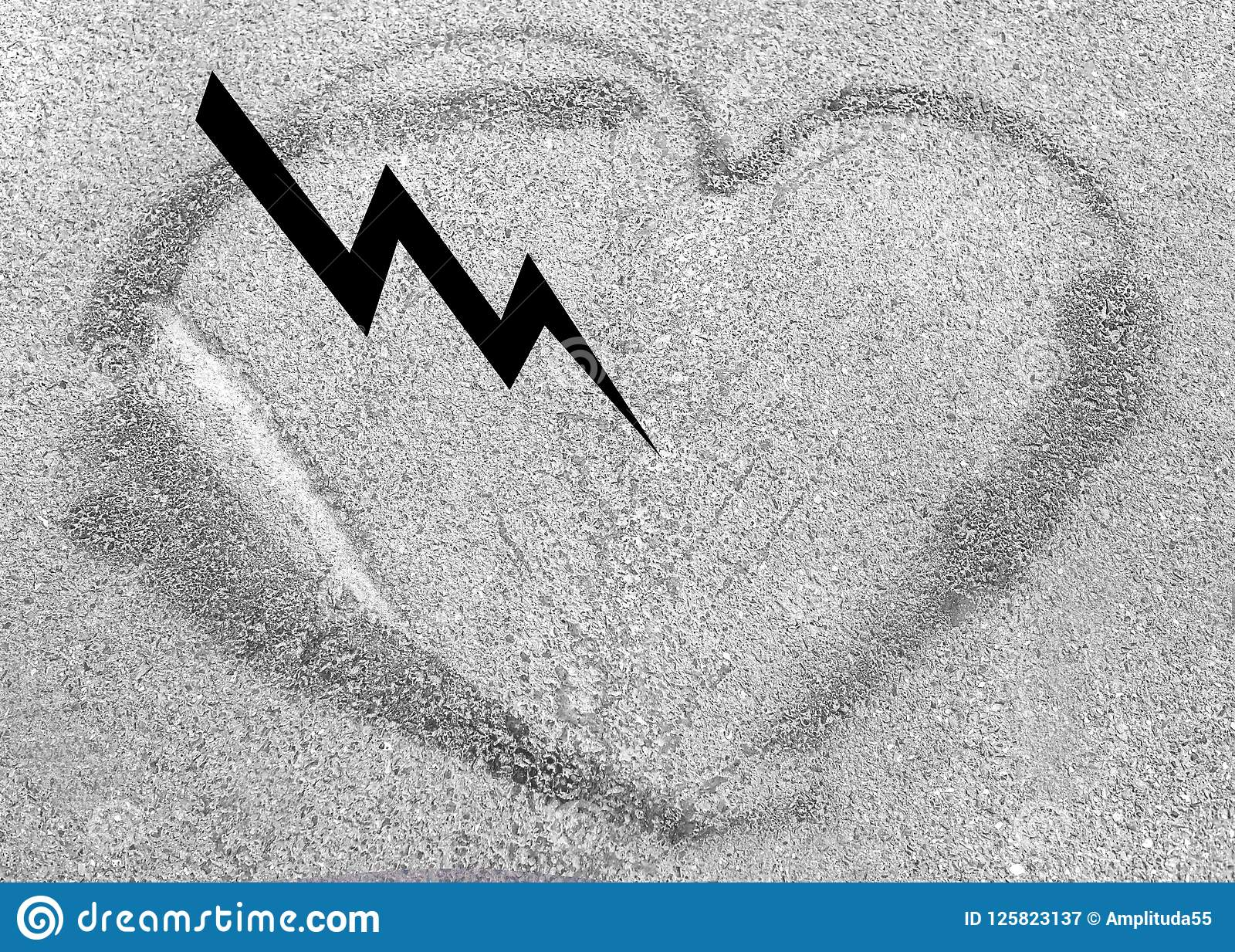 Heart shaped drawing on asphalt, love concept. lightning in the heart
