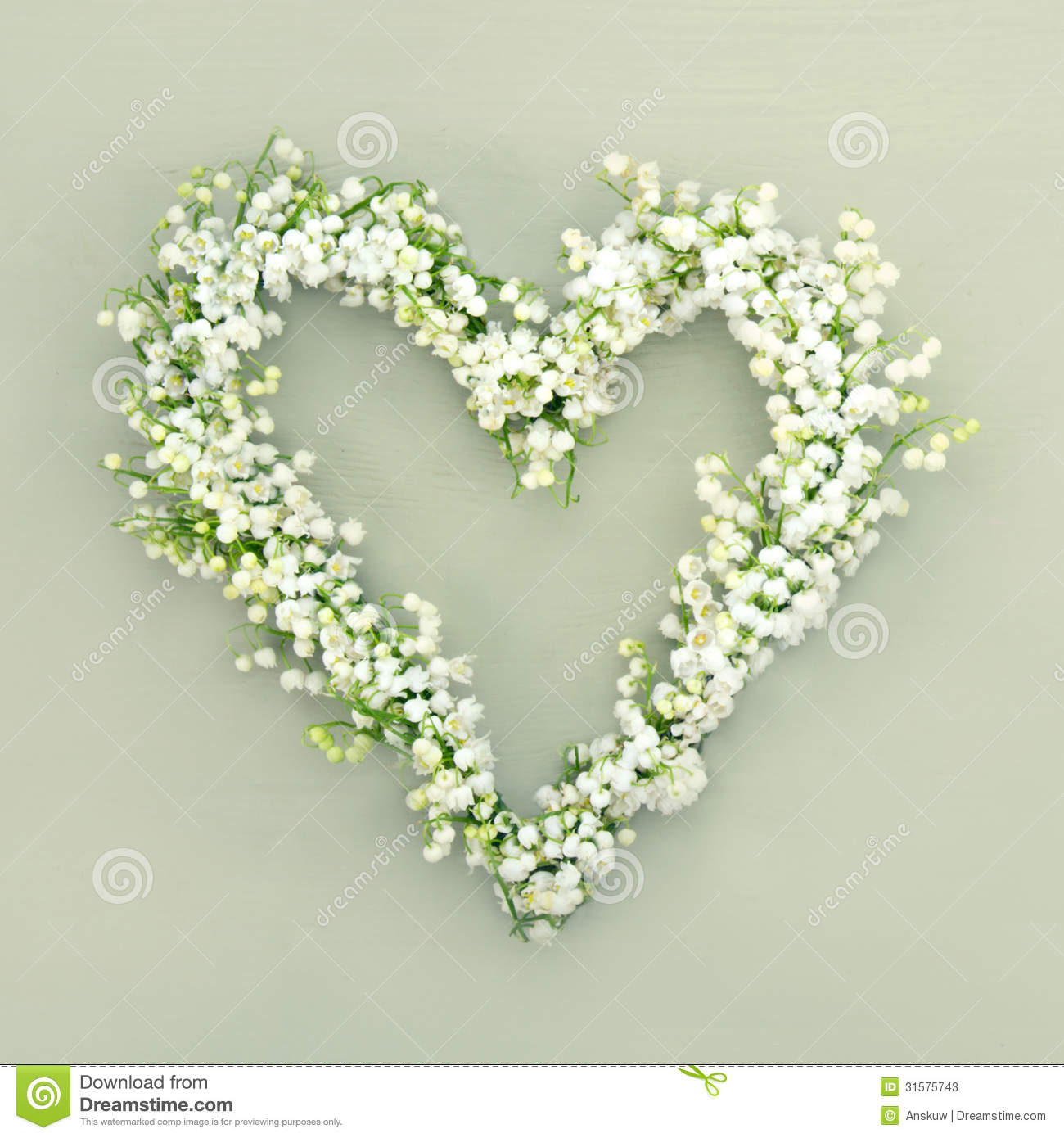 heart shaped flower wreath green background lilys valley wooden 31575743