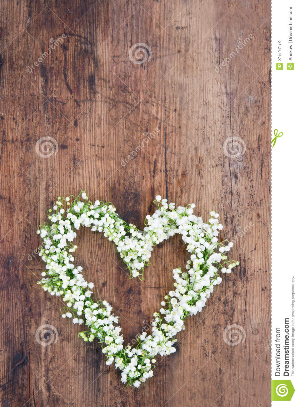 Heart Shaped Flower Wreath On Rustic Background