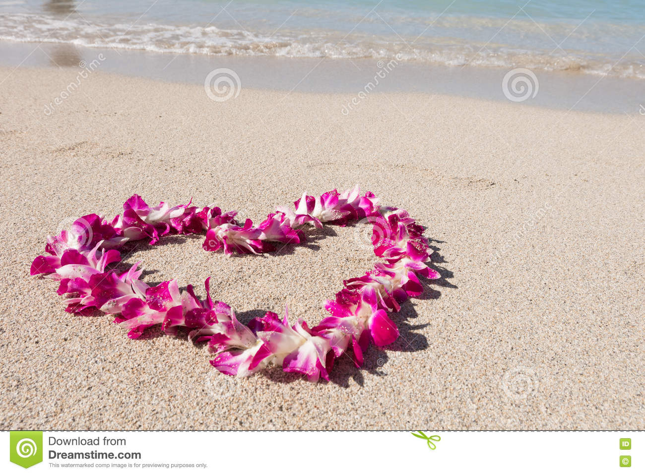 Heart shaped orchid flower garland white sea sand beach stock photo heart shaped orchid flower garland white sea sand beach izmirmasajfo