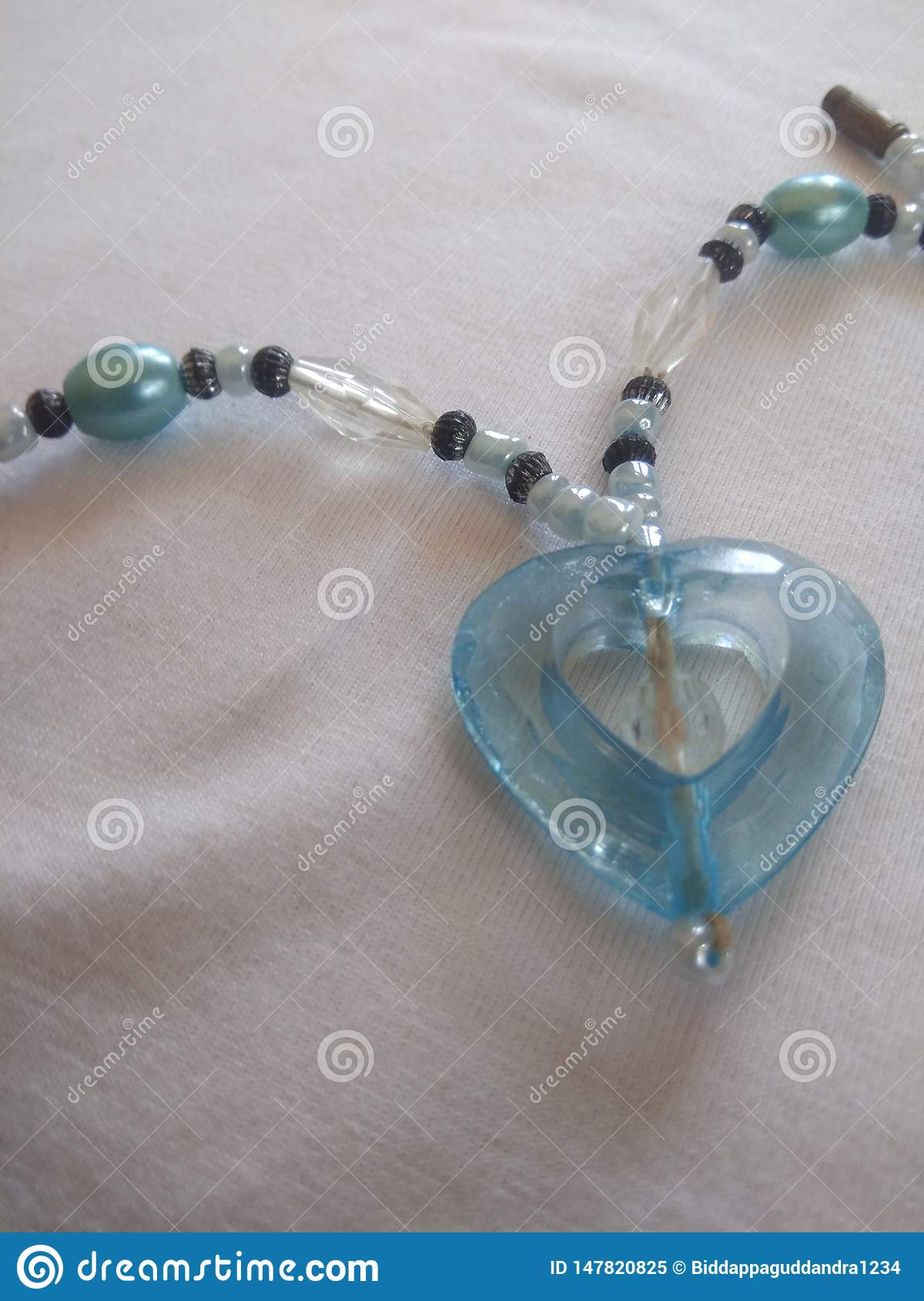 Heart shaped party wera chain with blue studs