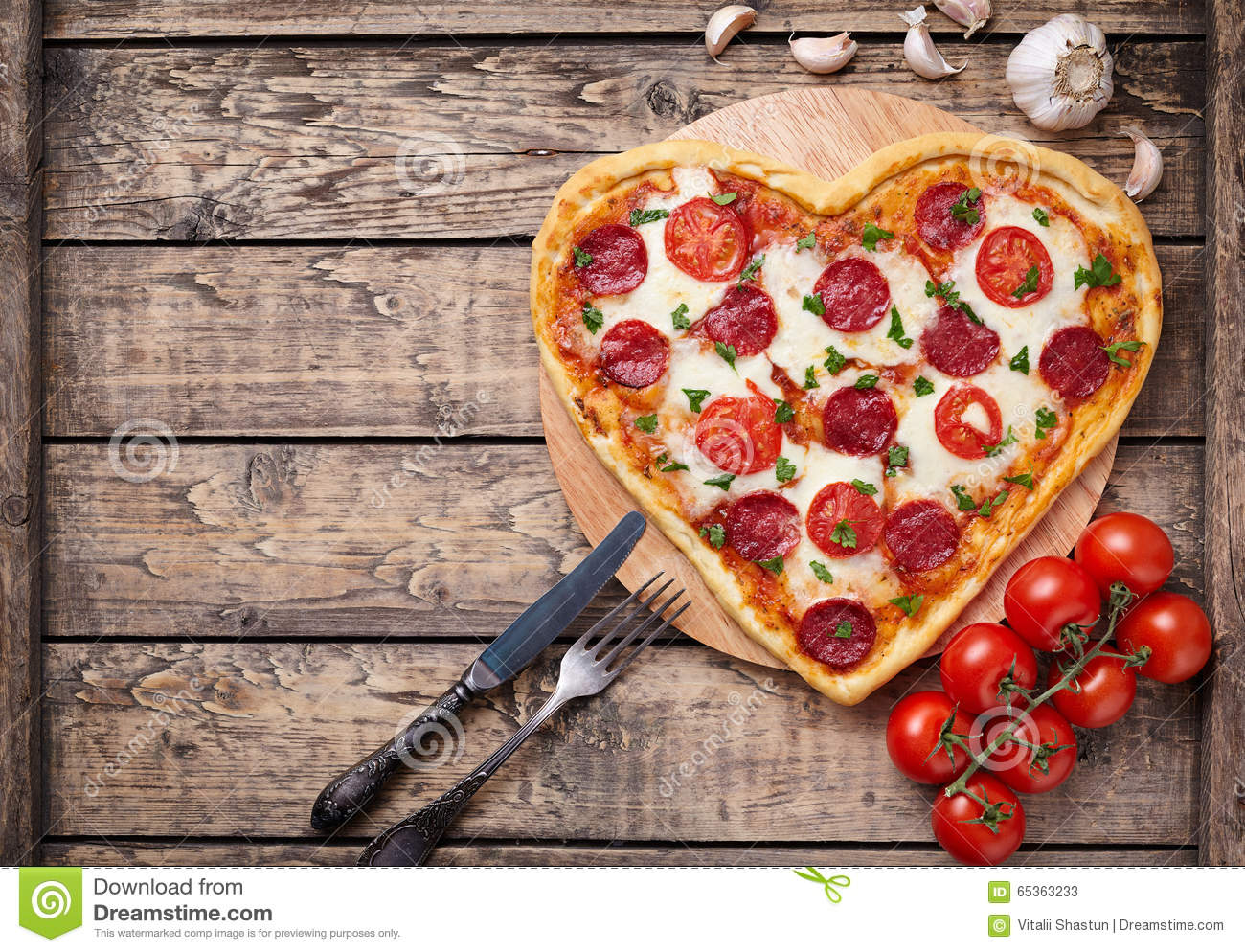 Heart Shaped Pizza With Pepperoni Tomatoes And Stock
