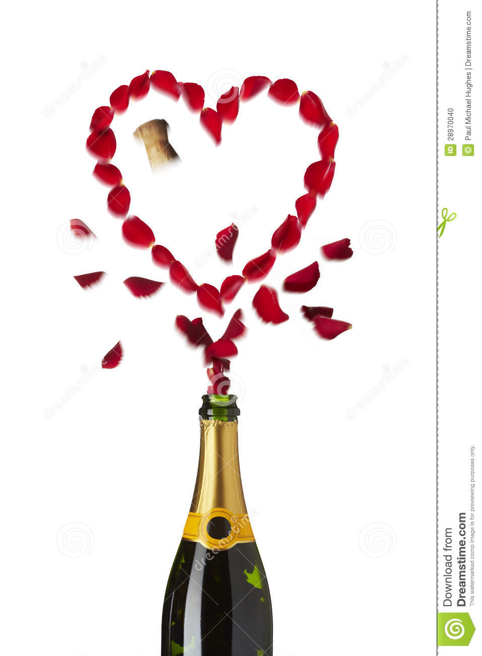 Heart shaped red rose petals champagne bottle