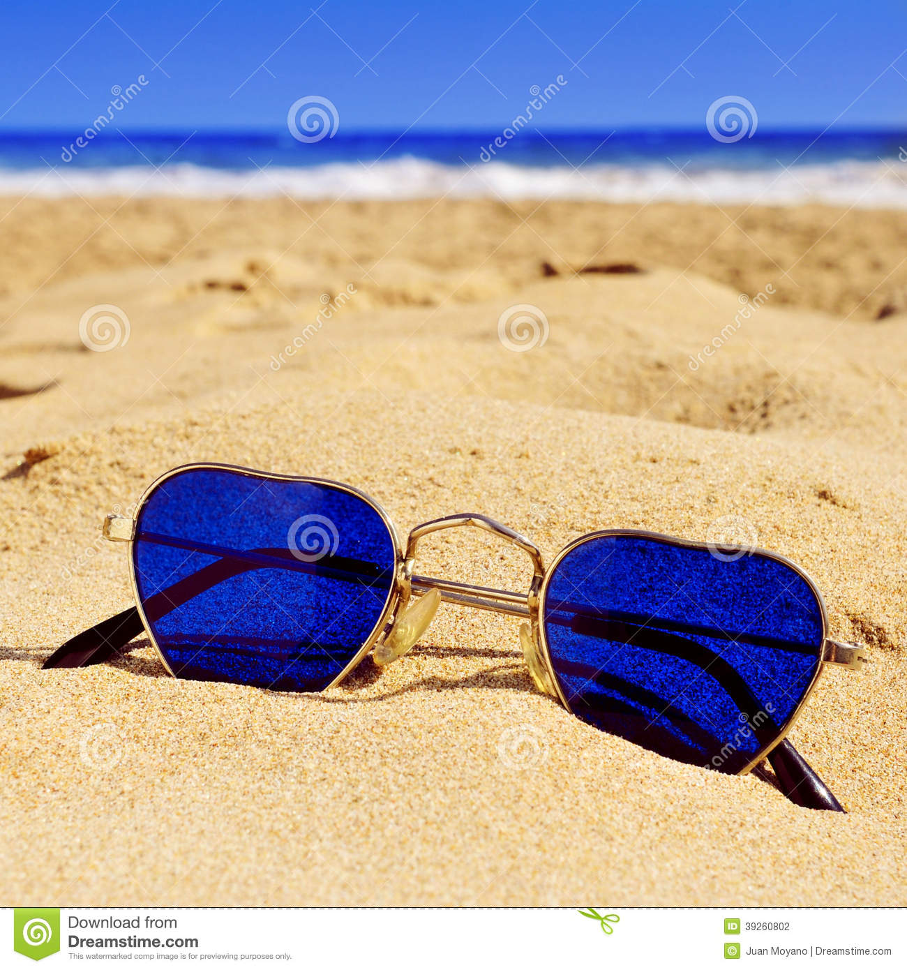 Heart-shaped Sunglasses In The Sand Of A Beach Stock Photo