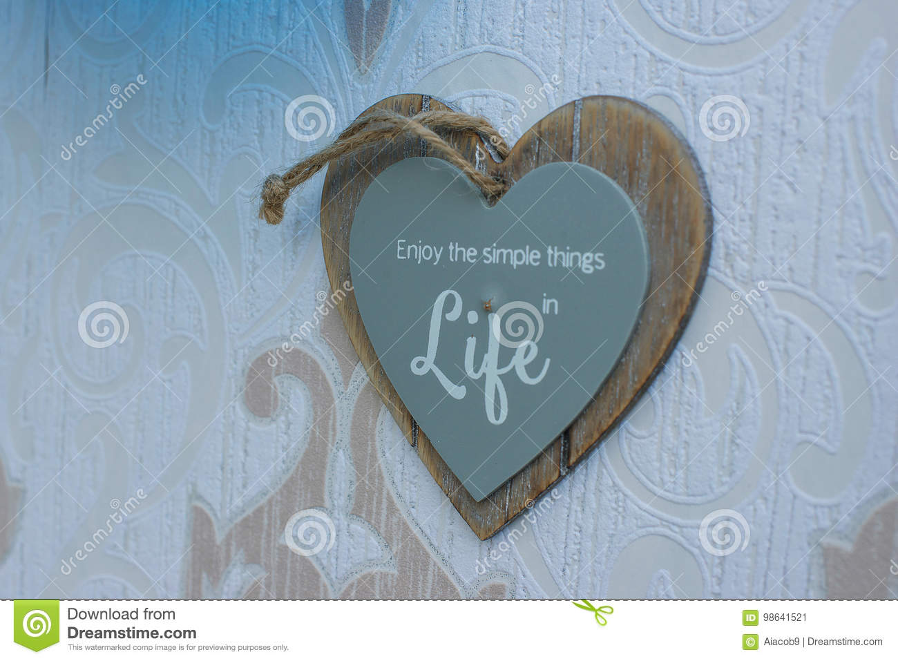 Heart Shaped Wooden Frame Sign Hang On The Wall Which Reads Enjoy