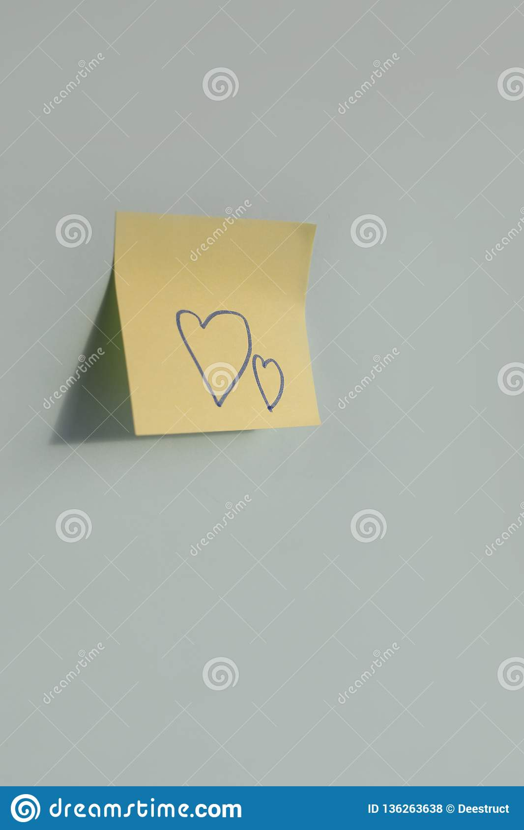 heart shapes handwritten on paper sticker on the blue background