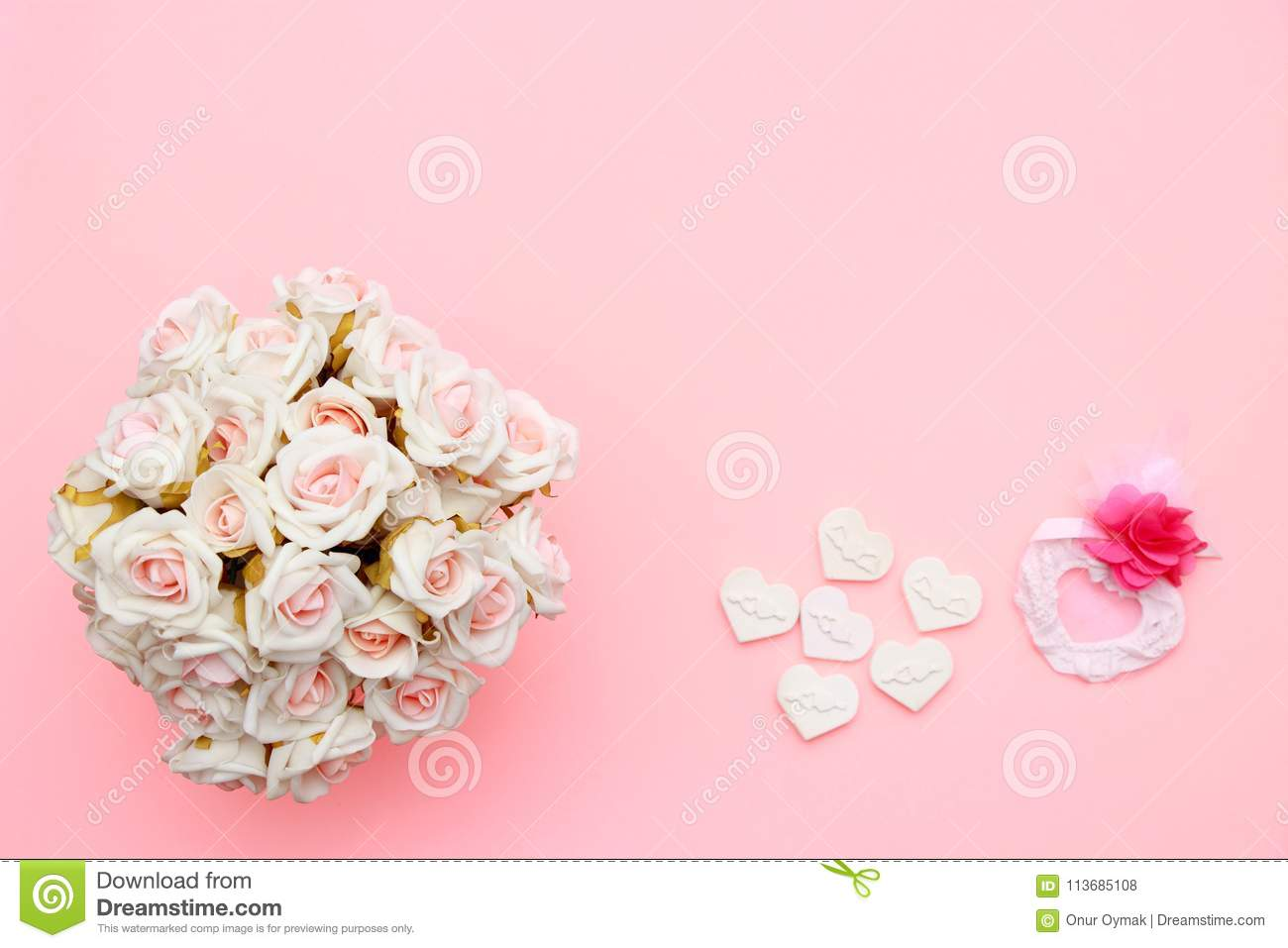 Heart symbol made of stone, white pink roses. Valentine`s and mothers day background. Flat lay, top view