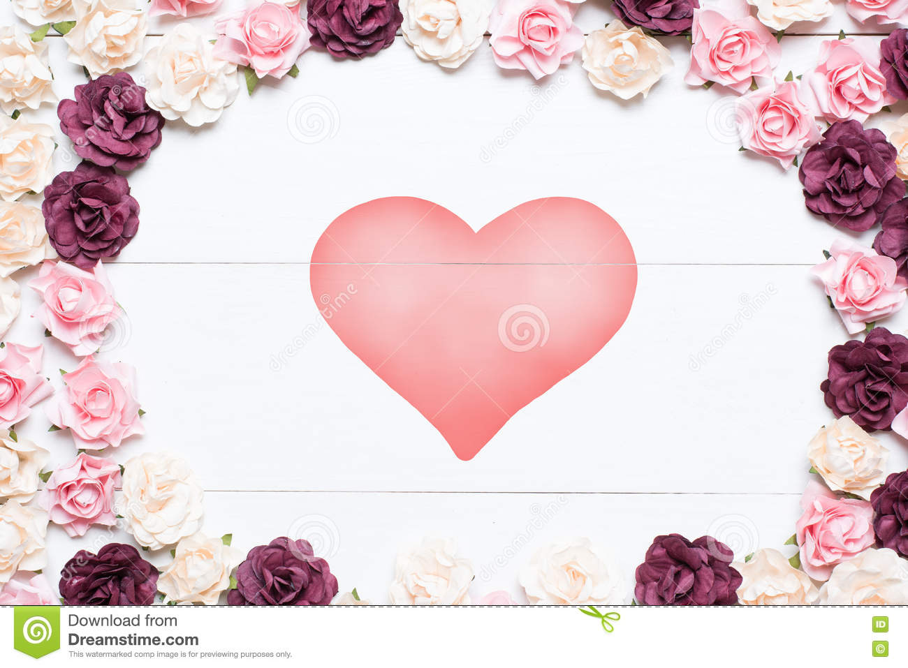 Heart symbol on white wooden table with pink red and white roses heart symbol on white wooden table with pink red and white roses buycottarizona Choice Image