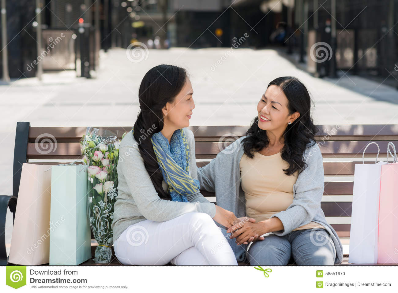 Heart to heart talk stock photo. Image of bench, casual
