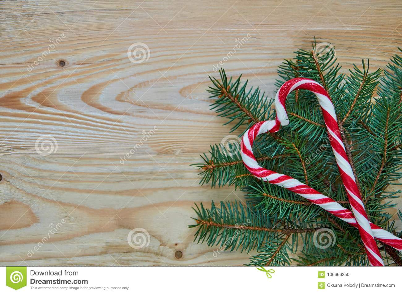 Heart Of Two Red Candy Cones On The Christmas Tree Branches With Free Copy Space On Left Side New Year Or Valentines Day Sweets Stock Photo Image Of Holiday Decor 106666250