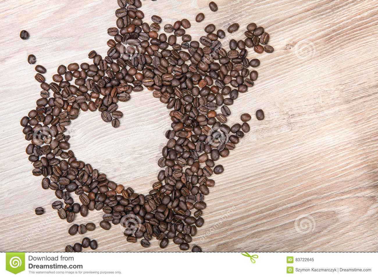 Heart Whit Coffee Beans On Wood Table Background. Stock Photo