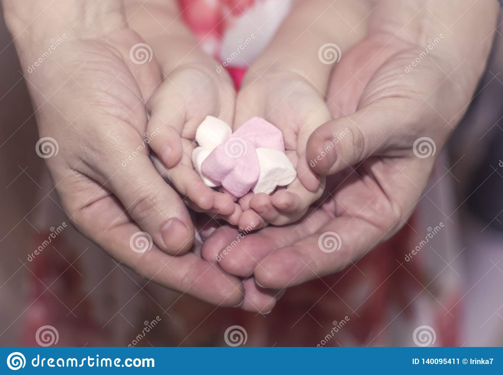 Hearts in children`s and women`s hands Kindness, family, love and charity concept, Valentine`s day or mother`s day gift.