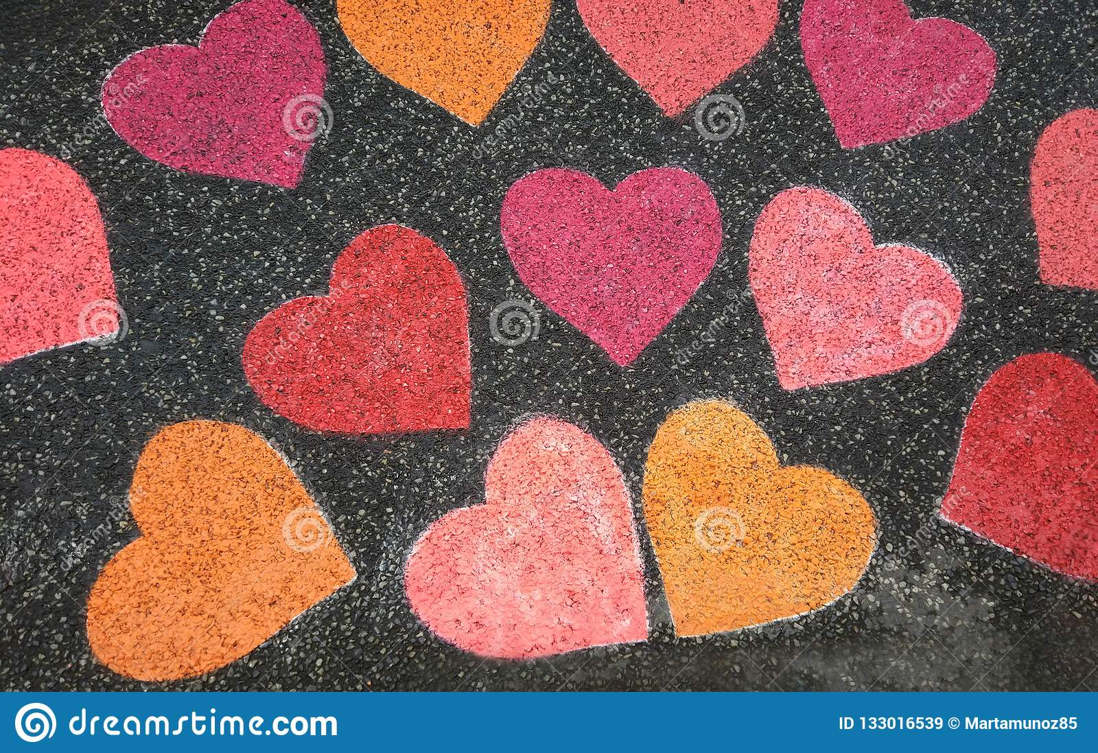 Hearts painted with colored chalk on the street