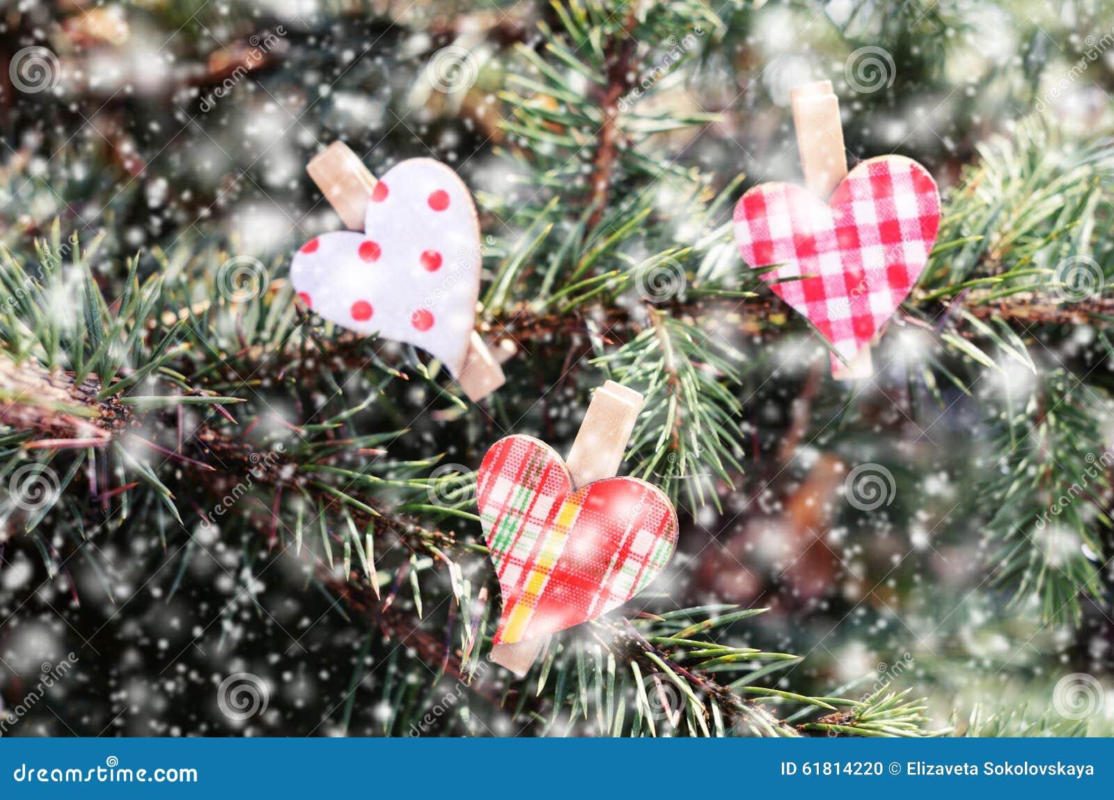 Hearts On Xmas Tree And Falling Snow Stock Photo