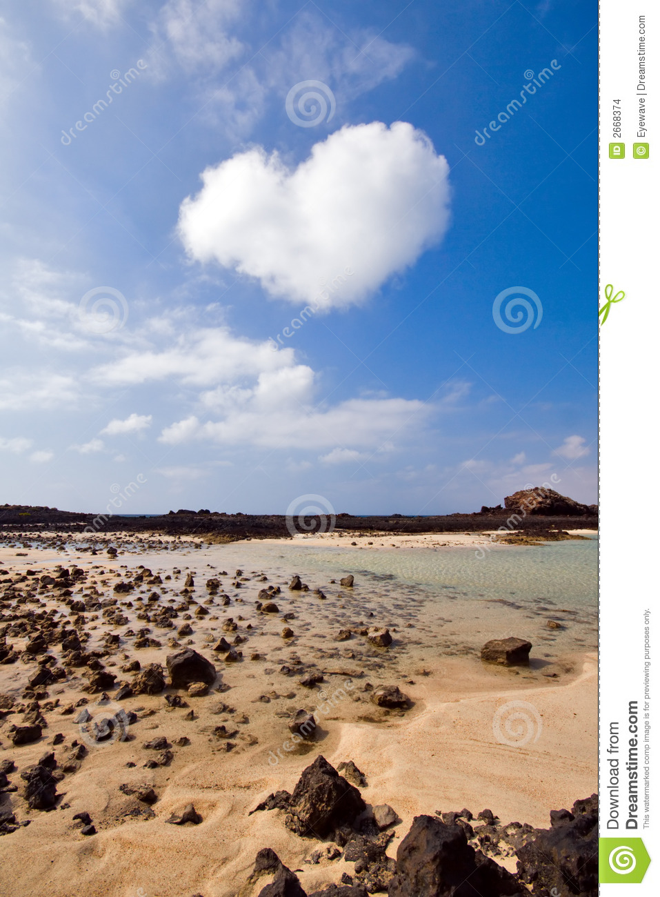 Heartshaped cloud above lagoon