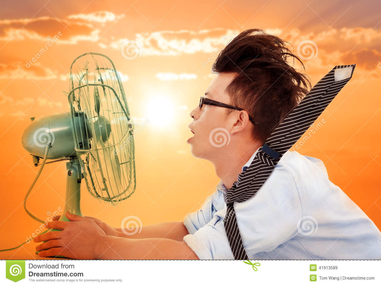 People Using Electric Fan : The heat wave is coming business man holding a electric