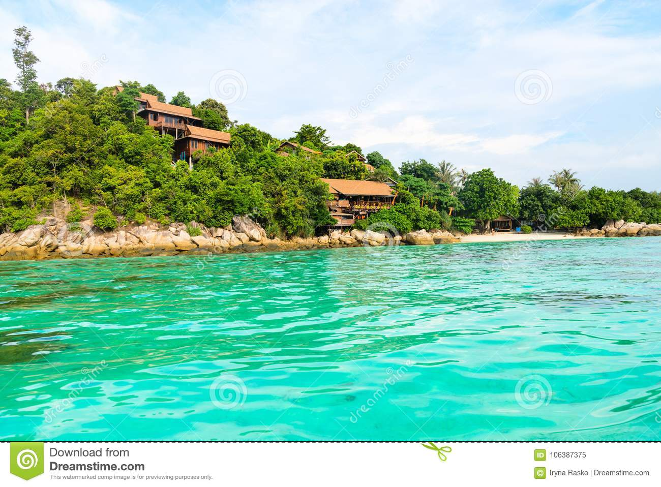 Heavenly green tropical island coast and small sand beach with c