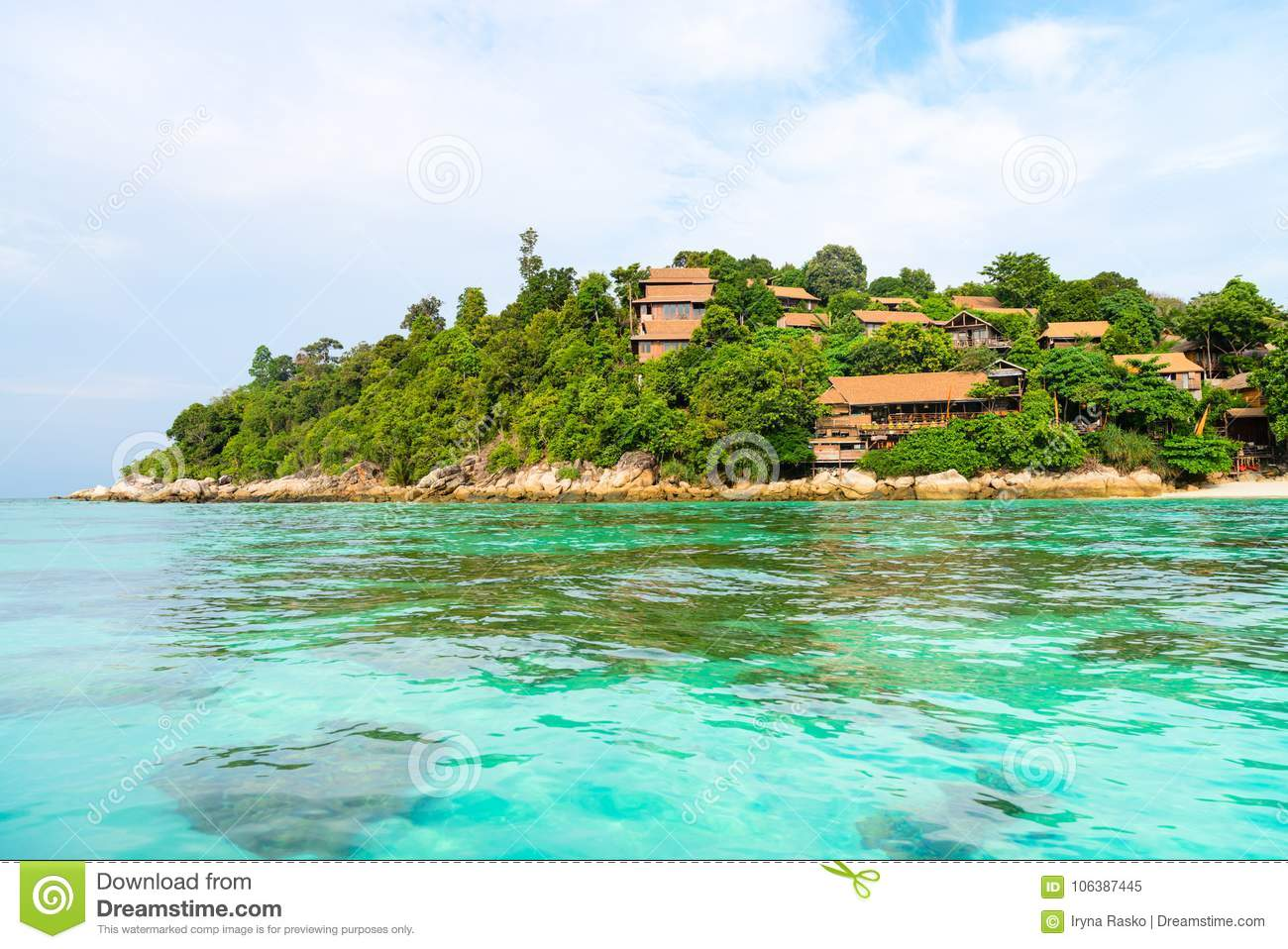 Heavenly green tropical island coast with clear sea and corals