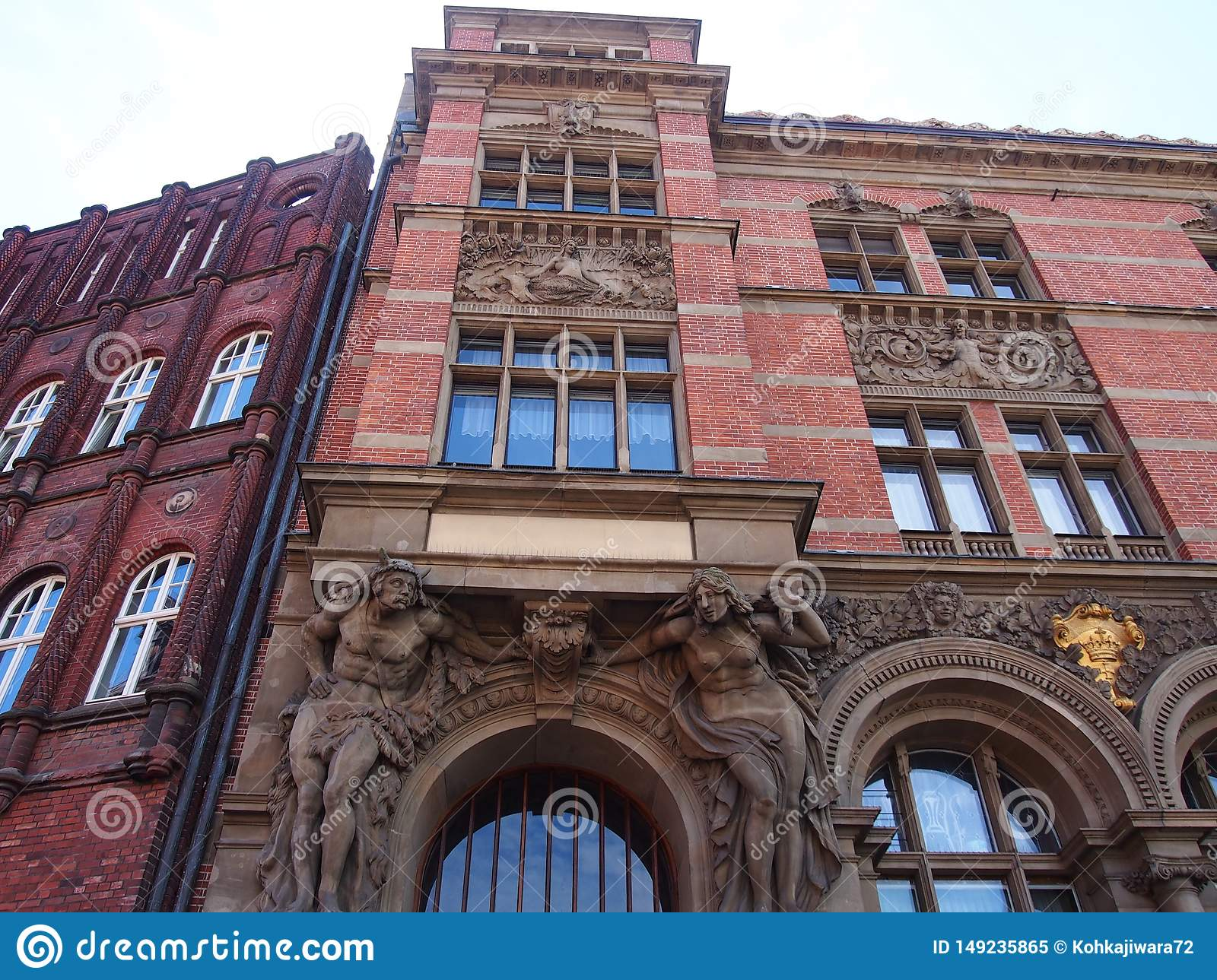 A heavily decorated classical buildings in gdansk, Poland red bricks, sculptures and arches