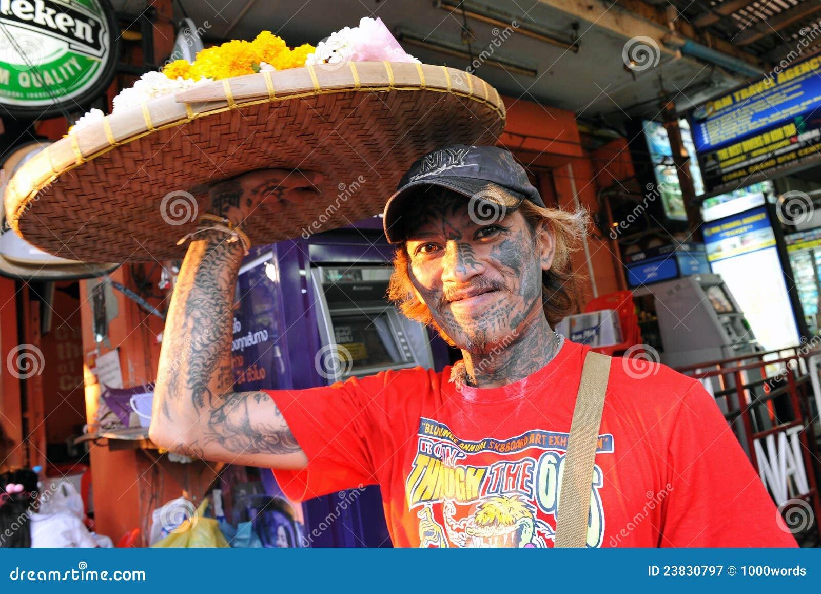 Heavily Tattooed Man Sells Flowers on Street