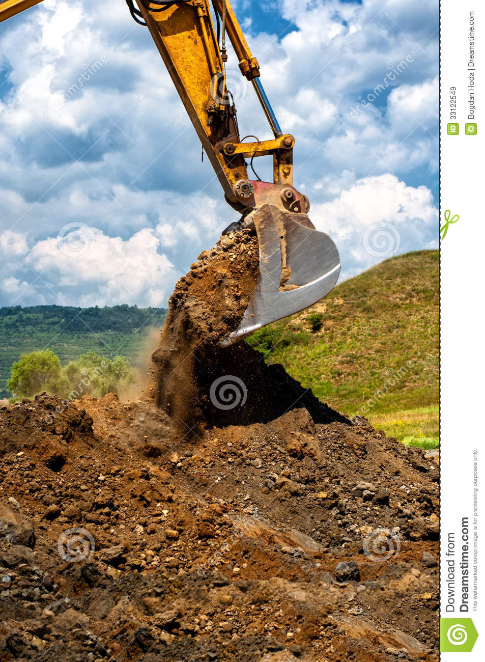 Construction Site Soil : Heavy duty vehicule scoop working with soil royalty free