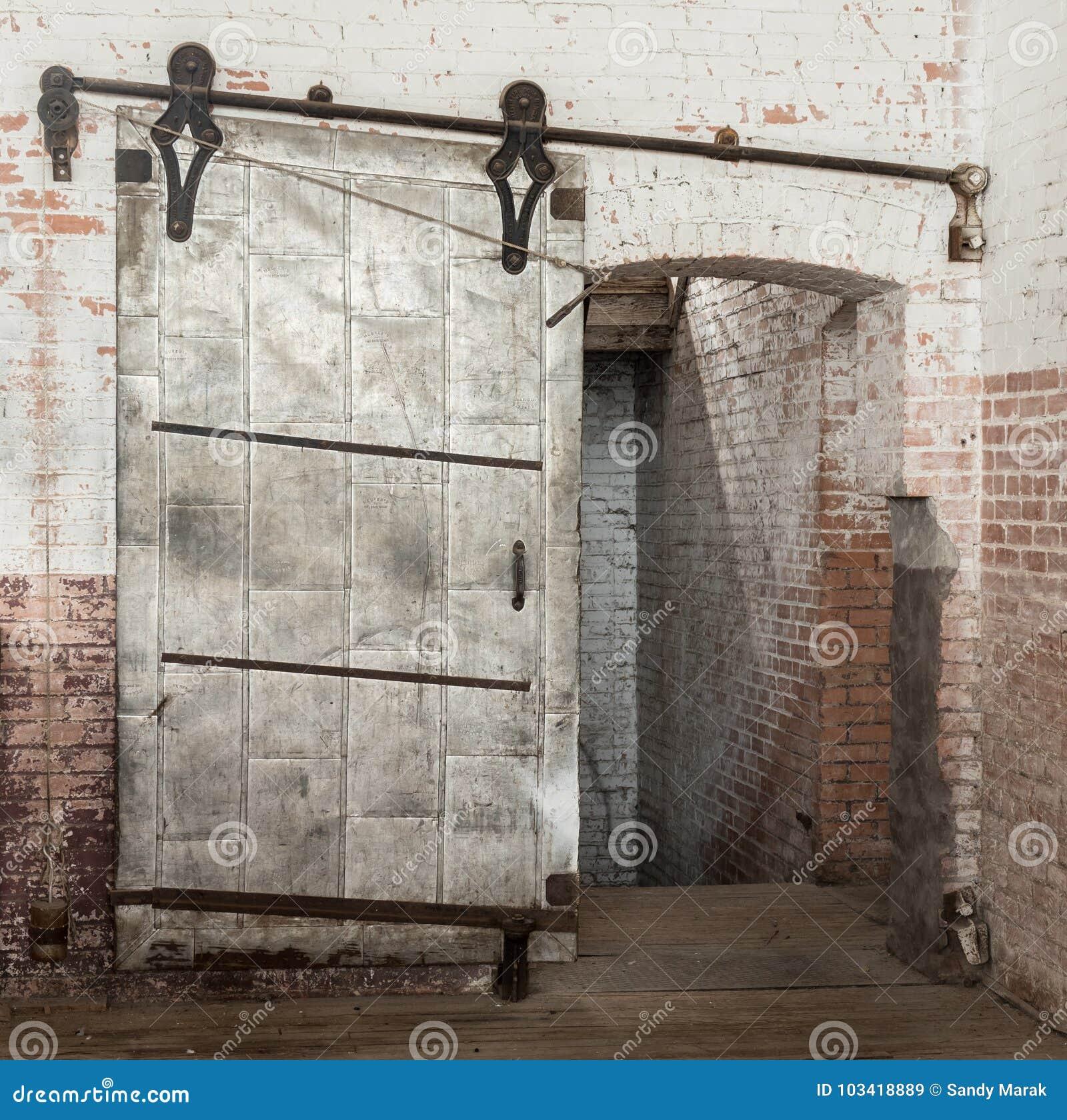 Sliding Heavy Industrial Metal Door In Old Warehouse Stock Image