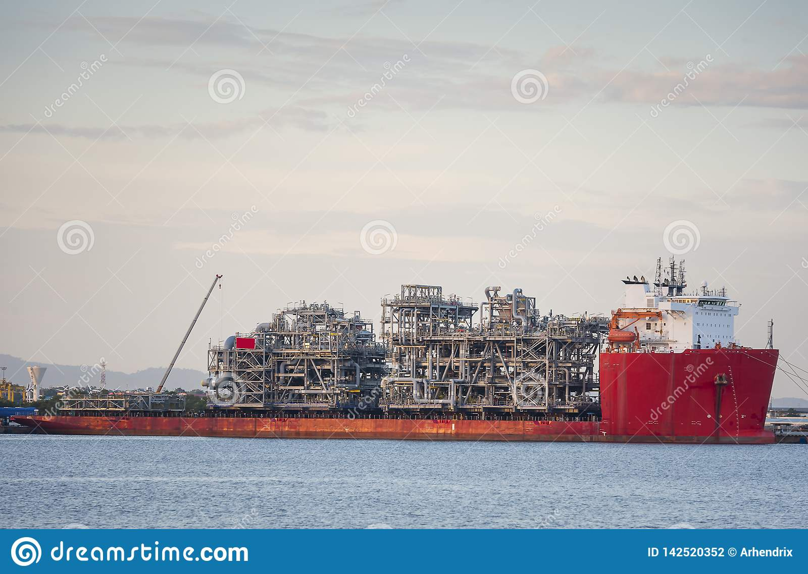 Heavy lift cargo ship barge transporting an oil rig Platform